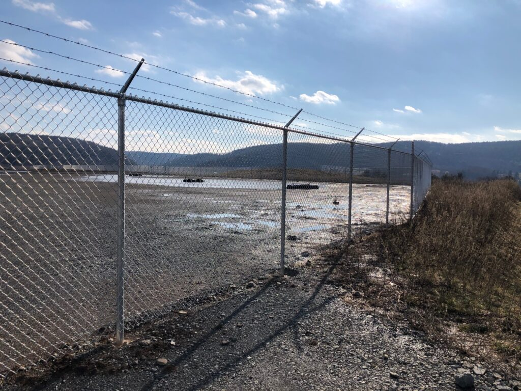 The site of a proposed liquified natural gas processing plant in Wyalusing, Pa., is fenced off but no work has progressed there. The sponsors of the project, which is slated to be operational in the first quarter of 2022, face daunting political, logistical and economic challenges.