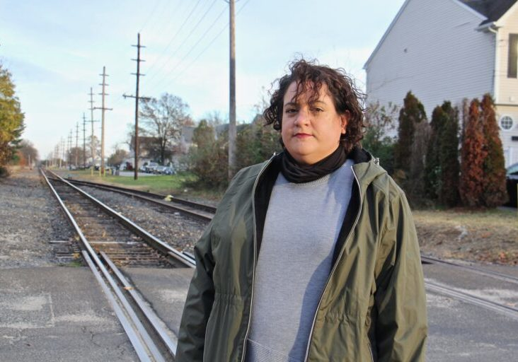 Vanessa Keegan, 41, lives in Gibbstown with her boyfriend and 3-year-old son a block from the railroad tracks that will carry liquid natural gas to an export facility on the Delaware River. (Emma Lee/WHYY)
