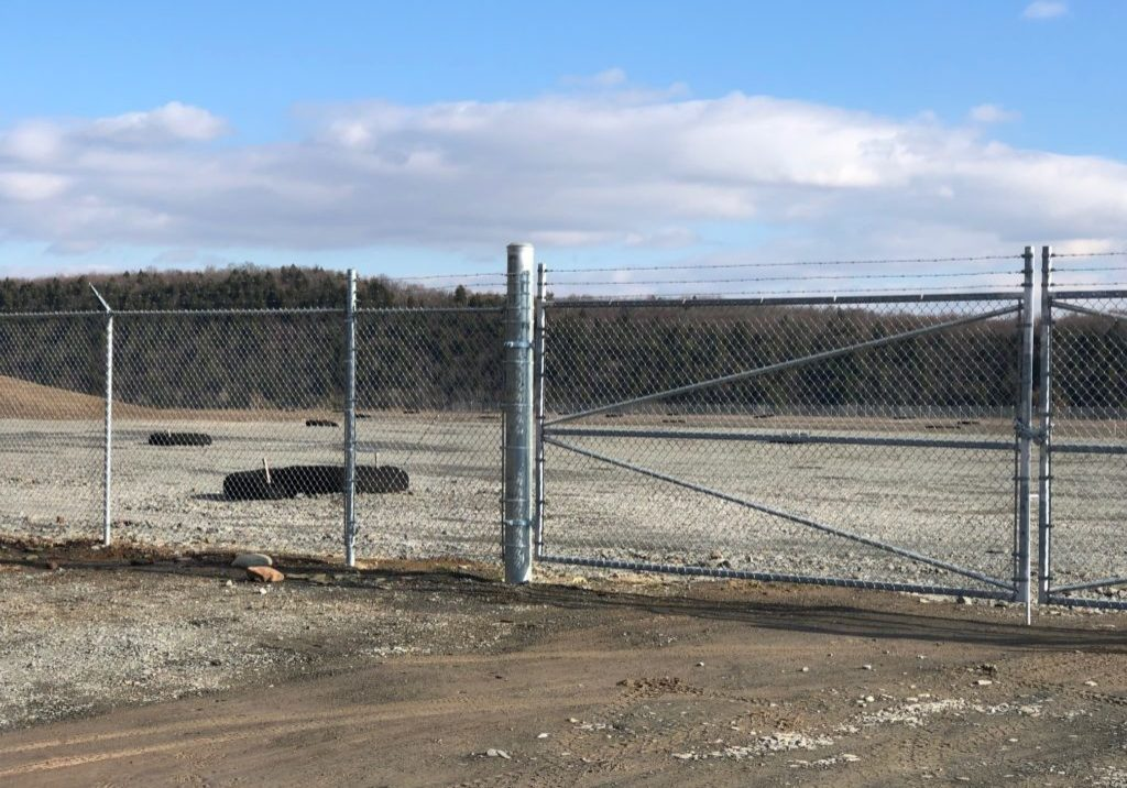 It doesn't look like much right now, but this plot of concrete is the foundation of a natural gas processing plant in Wyalusing, Pa., built by New Fortress Energy. Liquified natural gas would be transported from here by truck or rail to a port in Gibbstown, N.J., on the shores of the Delaware River. Construction is on a temporary delay. PHOTO BY CHRIS MELE