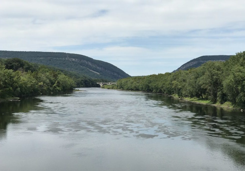 Looking north to the Delaware Water Gap (N.J. on the right, Pa. on the left) from the Portland-Columbia Pedestrian Bridge. The now disused Delaware River Viaduct crosses the river in the center of the photo. PHOTO BY MEG MCGUIRE
