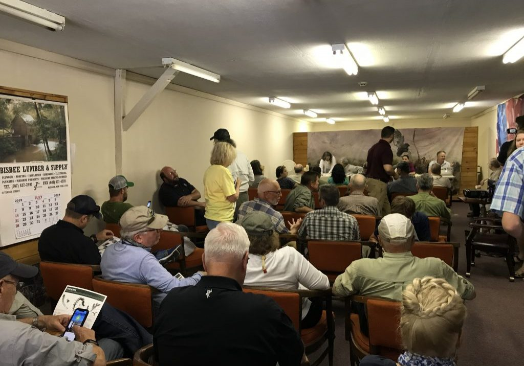 An SRO crowd gathered at the Hancock, N.Y. headquarters of the Friends of the Upper Delaware to hear the details of the new flow plan for the Delaware River. PHOTO BY MEG MCGUIRE