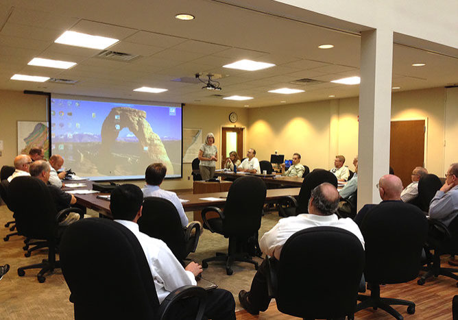 Laura Bittner, from the U.S. Army Corps of Engineers, presents information about a new modeling tool to the Flood Advisory Committee of the Delaware River Basin Commission, meeting at the United States Geological Survey offices in Lawrenceville, N.J. on Sept.7. PHOTO BY MEG MCGUIRE